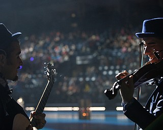 Camilo Motta, left, plays the guitar while Stepan Grytsay plays the violin before the start of Cirque Du Soleil Crystal in Covelli Centre on Wednesday.