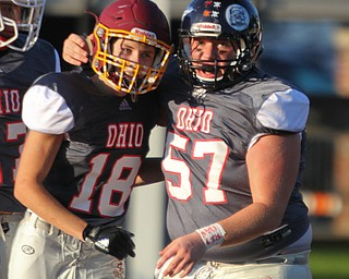William D. Lewis The Vindicator Ohio'sMathias Combs(18) of South range gets congrats from Logan Olenik(57) of Leetonia after scoring during 6-28-18 Penn Ohio game in Salem.