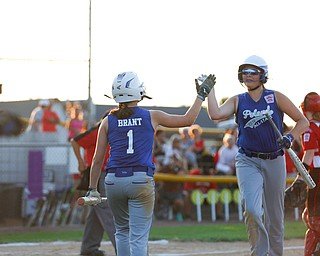 Poland's Mary Brant high-fives Katie McDonald during the district championship game against Canfield on Sunday.