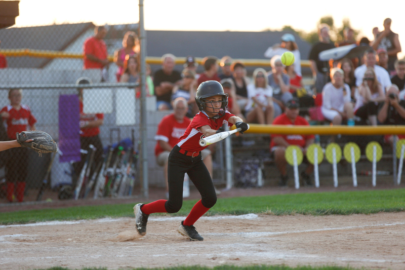 Canfield's Gianna Pannanzio bunts during the district championship game against Poland on Sunday.