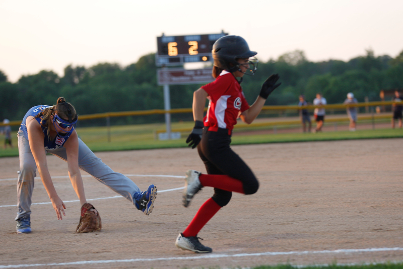 Poland's Katie McDonald fields the ball as Canfield's Gianna Pannanzio runs past during the district championship game on Sunday.