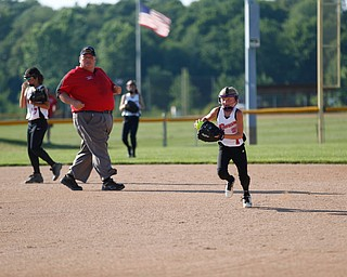 Canfield's Brooke O'Palick runs Austintown's Kaliana Ray back to first during the 10u softball tournament on Sunday.