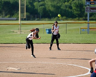 Canfield's Sammi Economous throws the ball to first during the 10u softball tournament against Austintown on Sunday.