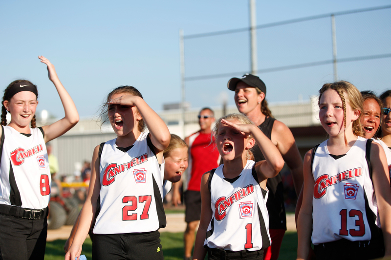 Canfield's 10u softball team cheers to the crowd after winning against Austintown during a tournament game on Sunday.