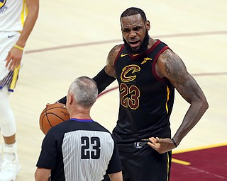 Cleveland Cavaliers' LeBron James argues a call with referee Jason Phillips during the first half of Game 4 of basketball's NBA Finals against the Golden State Warriors, Friday, June 8, 2018, in Cleveland. (AP Photo/Carlos Osorio)