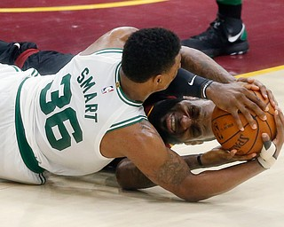 Cleveland Cavaliers' LeBron James, rear, and Boston Celtics' Marcus Smart battle for the ball during the second half of Game 6 of the NBA basketball Eastern Conference finals  Friday, May 25, 2018, in Cleveland. The Cavaliers won 109-99. (AP Photo/Ron Schwane)