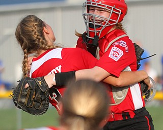 William D. Lewis The Vindicator  Canfield pitcher Bella Kennedy(3) left, gets congrats from catcher(12) after 7-2-18 win over Poland at Fields of Dreams.