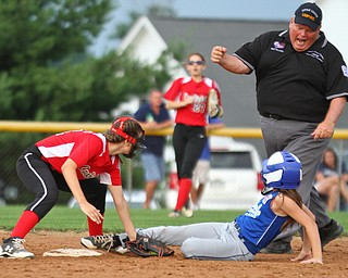 William D. Lewis The Vindicator Umpire Mike Williams calls Poland's (14) out. Making the tag for canfield is (21)  during 7-2-18 win over Poland at Fields of Dreams.