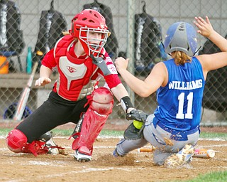 William D. Lewis The Vindicator  Canfield catcher(12) tags Poland's( 11)during 7-2-18 win over Poland at Fields of Dreams.