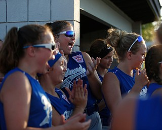Poland's 12u softball team cheers as its teammates get called onto the field at the beginning of the district championship game against Canfield on Sunday.