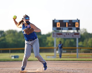 Katie McDonald, a pitcher for Poland's 12u softball team, throws the ball to first during the first inning of the district championship game against Canfield on Sunday.