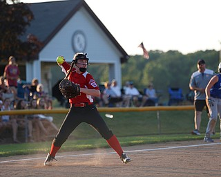 Canfield's Emma Campbell throws the ball to first during the  district championship game against Poland on Sunday.