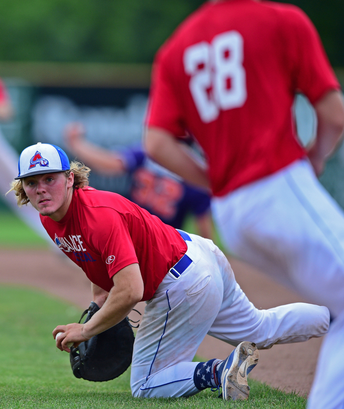 STRUTHERS, OHIO - JULY 3, 2018: Avalanche' Jamin Wentling looks to flip the ball to starting pitcher Garrett Brewer in the second inning of a baseball game against XXX, Tuesday, July 3, 2018 in Struthers. DAVID DERMER | THE VINDICATOR