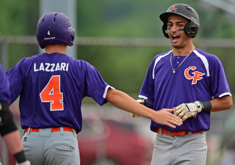 STRUTHERS, OHIO - JULY 3, 2018: Creekside' Alex Hernandez, right, is congratulated by Clay Lazzari after scoring in the second inning of a baseball game against Avalanche, Tuesday, July 3, 2018 in Struthers. DAVID DERMER | THE VINDICATOR