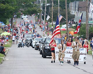 The Boy Scouts held flags at the start of the parade as it traveled up Sexton street during the Struthers Fourth of July Parade on Wednesday afternoon.  Dustin Livesay  |  The Vindicator  7/4/18  Struthers