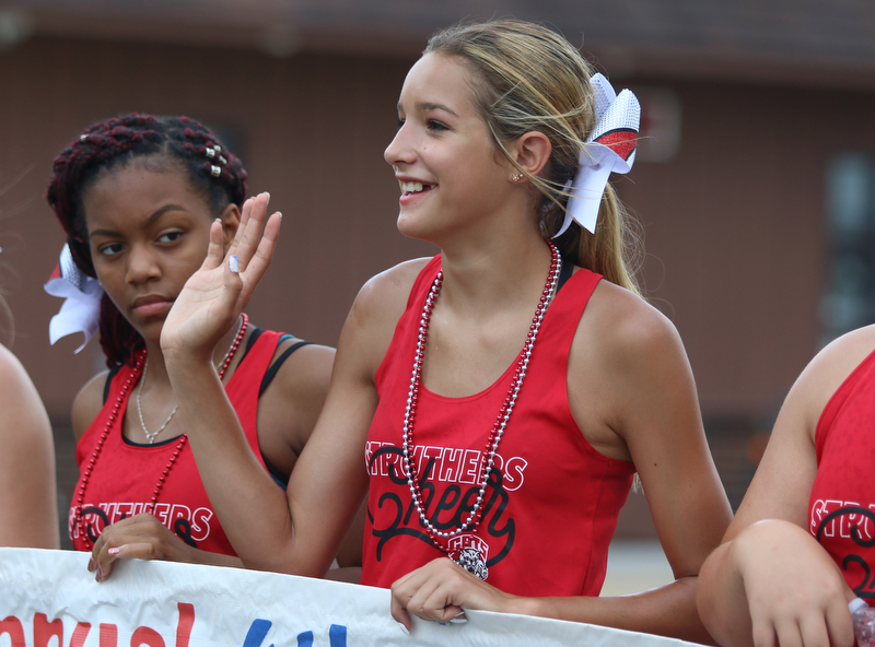 McKenna DePascquale (14) of the Struthers cheer squad waves to spectators during the Struthers Fourth of July Parade on Wednesday afternoon.  Dustin Livesay     The Vindicator  7/4/18  Struthers