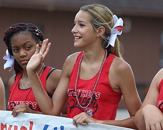 McKenna DePascquale (14) of the Struthers cheer squad waves to spectators during the Struthers Fourth of July Parade on Wednesday afternoon.  Dustin Livesay  |  The Vindicator  7/4/18  Struthers