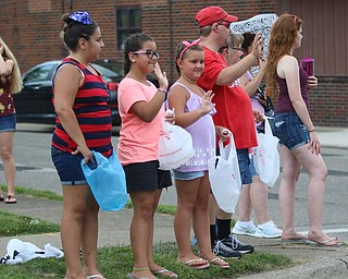 Sofie Previte (10) of Struthers, Zoe Crespo (9), and Gia Crespo (7) of Boardman wave to the floats as they go by during the Struthers Fourth of July Parade on Wednesday afternoon.  Dustin Livesay  |  The Vindicator  7/4/18  Struthers