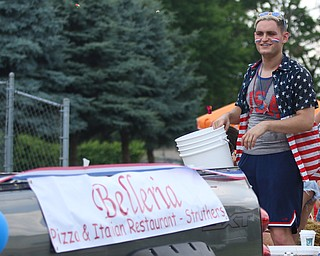Brian Vulcan throws out candy while on the Belleria float during the Struthers Fourth of July Parade on Wednesday afternoon.  Dustin Livesay  |  The Vindicator  7/4/18  Struthers