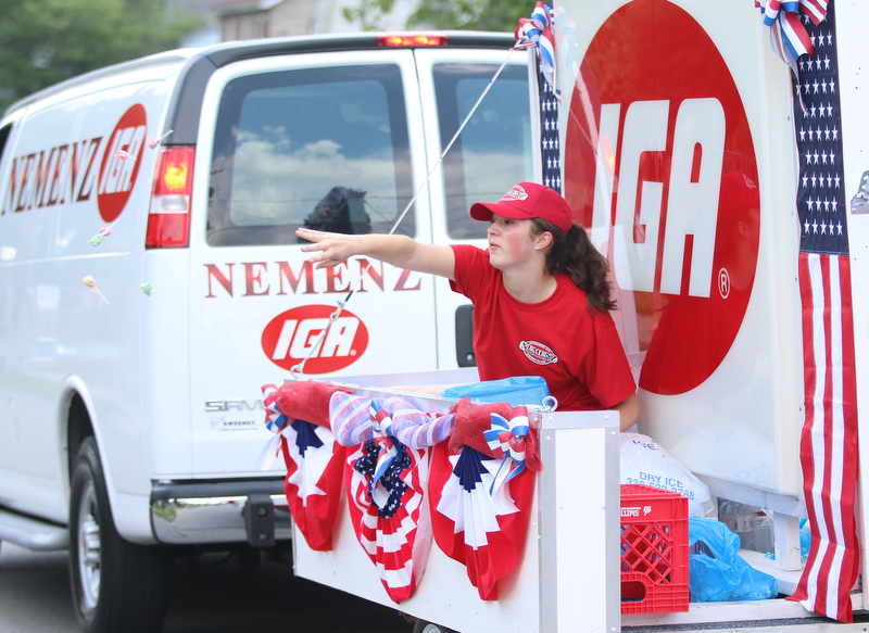 Gina Gabriele throws out candy while on the Nemenez IGA float during the Struthers Fourth of July Parade on Wednesday afternoon.  Dustin Livesay  |  The Vindicator  7/4/18  Struthers
