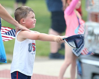 Colin Hallquist (4) of Struthers holds out his hat for candy during the Struthers Fourth of July Parade on Wednesday afternoon.  Dustin Livesay  |  The Vindicator  7/4/18  Struthers