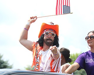 "Dan Lancy of Struthers waves a flag while dressed up as former wrestling star ""Macho Man Randy Savage"" during the Struthers Fourth of July Parade on Wednesday afternoon.  Dustin Livesay  