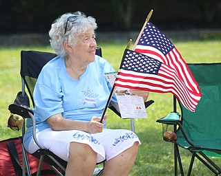 Bettie Christman of Brookfield waves flags as she retreats to the shade during the Struthers Fourth of July Parade on Wednesday afternoon.  Dustin Livesay  |  The Vindicator  7/4/18  Struthers