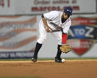Jose Fermin (12) of the Scrappers scoops a ground ball during the top of the second inning against Batavia at Eastwood Field on Thursday evening. Dustin Livesay     The Vindicator  7/5/18  Niles
