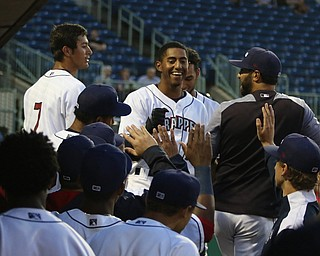 Richie Palacios (17) of the Scrappers (center) gets greeted by his teammates in the dugout after hitting a home run during the bottom of the first inning against .batavia at Eastwood Field on Thursday evening. Dustin Livesay  |  The Vindicator  7/5/18  Niles