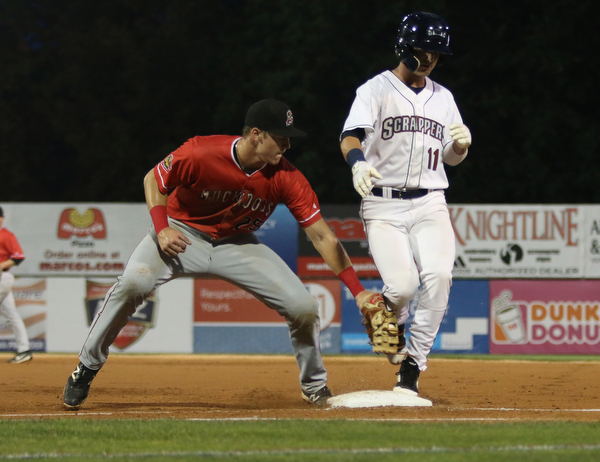 Clark Scolamiero (11) of the Scrappers steps back to first base beating the tag by Batavia first basemen Sean Reynolds (25) during the bottom of the second inning at Eastwood Field on Thursday evening. Dustin Livesay  |  The Vindicator  7/5/18  Niles