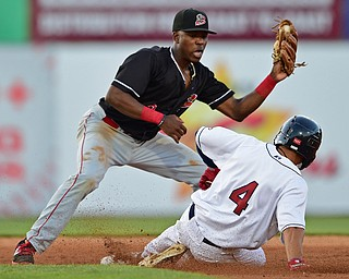 NILES, OHIO - JULY 6, 2018: Batavia Muckdogs' Demetrius Sims looks before unsuccessfully applying a tag to Mahoning Valley Scrappers' Tre Gantt after Batavia Muckdogs' Albert Guaimaro dropped the ball in the third inning of a baseball game against the Batavia Muckdogs, Friday, July 6, 2018, in Niles. DAVID DERMER | THE VINDICATOR
