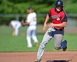 STRUTHERS, OHIO - JULY 7, 2018: KnightLine's Kevin Pollock runs to third base on a double by Kole Klasic in the first inning of a baseball game against Astro, Saturday, July 7, 2018, in Struthers. DAVID DERMER | THE VINDICATOR