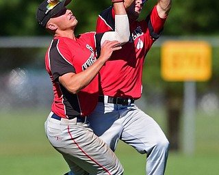 STRUTHERS, OHIO - JULY 7, 2018: Knightline' Colton Stoneman, right, and Kole Klassic collide as Stoneman catches fly out in the first inning of a baseball game against Astro, Saturday, July 7, 2018, in Struthers. DAVID DERMER | THE VINDICATOR