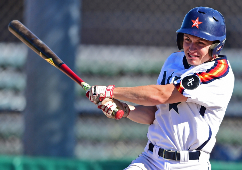 STRUTHERS, OHIO - JULY 7, 2018: Astro's Marco Defalco hits a RBI-single in the third inning of a baseball game against KnightLine, Saturday, July 7, 2018, in Struthers. DAVID DERMER | THE VINDICATOR