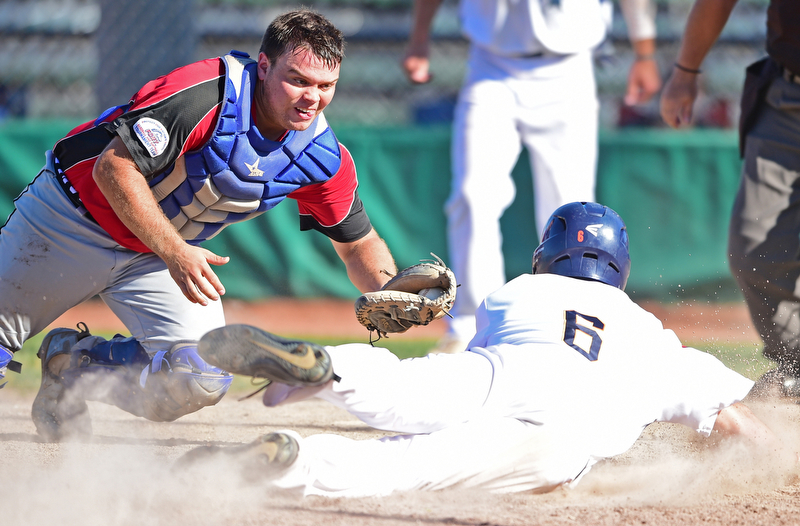STRUTHERS, OHIO - JULY 7, 2018: Knightline's Tim Herberger, left, prepares to tag out Astro's Marco Defalco in the third inning of a baseball game against KnightLine, Saturday, July 7, 2018, in Struthers. DAVID DERMER | THE VINDICATOR