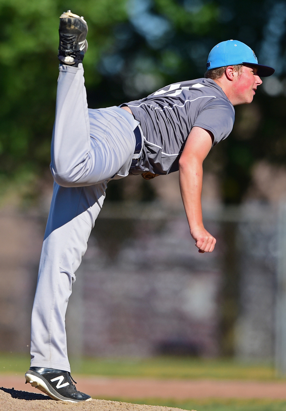 STRUTHERS, OHIO - JULY 7, 2018: Roth Brothers starting pitcher Marshall Wheeler delivers in the fourth inning of a baseball game against Baird Brothers, Saturday, July 7, 2018, in Struthers. DAVID DERMER | THE VINDICATOR