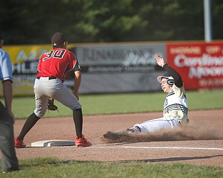 Baird Brothers' Andrew Russell slides into third while Knightline's Anthony Cinicola waits for the ball during the Class B tournament game on Tuesday.