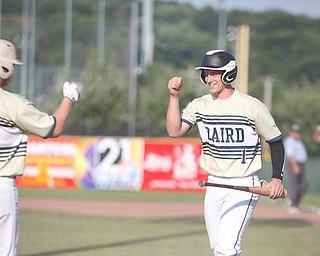 Baird Brothers' Andrew Russell, right, and Jacob Keene fist bump after Russell scores in the second inning of the Class B tournament game against Knightline on Tuesday.