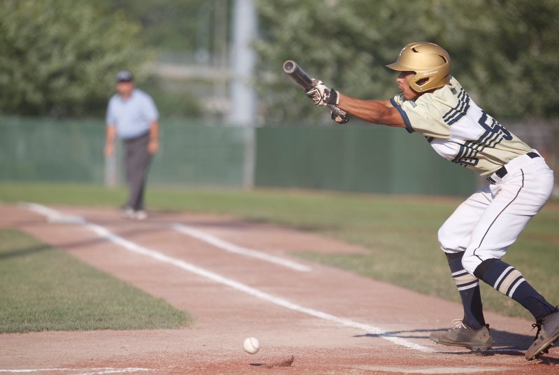 Baird Brothers' Dayln Brickner lays down a bunt during the third inning of the Class B tournament game against Knightline on Tuesday.