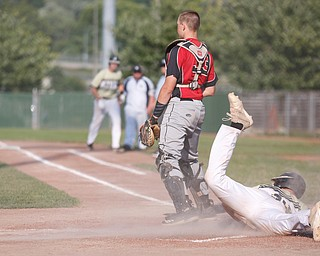 Baird Brothers' Coleman Stauffer slides into home and scores in the third inning of the Class B tournament game against Knightline on Tuesday.