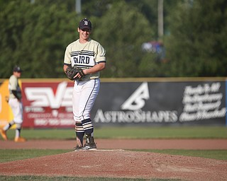 Baird Brothers' Andrew Russell smiles after pitching a strike in the fourth inning of the Class B tournament game against Knightline on Tuesday.