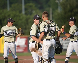Baird Brothers' Jacob McCaskey, far left, and Dylan Swarmer, far right, run off the field while Andrew Russel and Coleman Stauffer talk after holding Knightlife 2-0 at the end of the fourth inning of the Class B tournament game against Knightline on Tuesday.