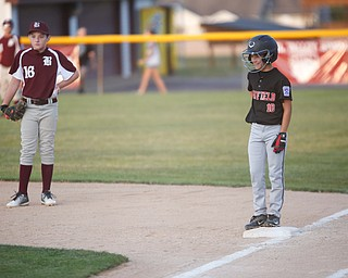 Canfield's Drew Snyder smiles after hitting the ball during the Little League baseball 11-U playoff game against Boardman on Wednesday.