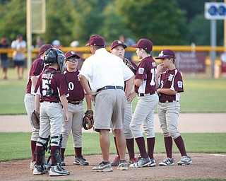 Boardman's infield huddles after Canfield scores two runs in the first inning of the Little League baseball 11-U playoff game on Wednesday.