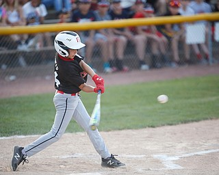 Canfield's Jake Bednar hits the ball during the Little League baseball 11-U playoff game against Boardman on Wednesday.