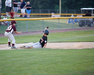 Canfield's Drew Snyder slides safely into third during the Little League baseball 11-U playoff game against Boardman on Wednesday.