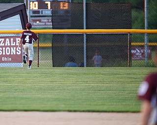 Boardman's Mike Demetrios watches the ball, hit by Canfield's Dylan Mancini, go over the fence during the Little League baseball 11-U playoff game on Wednesday.