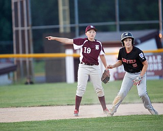 Boardman's Mason Nawrocki points to third as Canfield's Angelo Delucia takes a lead during the Little League baseball 11-U playoff game on Wednesday.