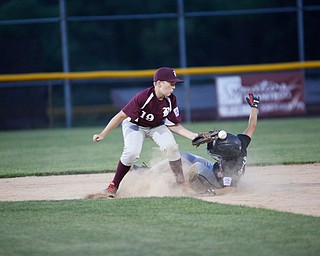 Boardman's Mason Nawrocki misses the throw from home as Canfield's Drew Snyder slides into second during the Little League baseball 11-U playoff game on Wednesday.