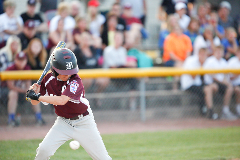 Boardman's Marty Stachowicz watches a pitch during the second inning of the 12u district championship game against Poland at Field of Dreams in Boardman on Thursday.